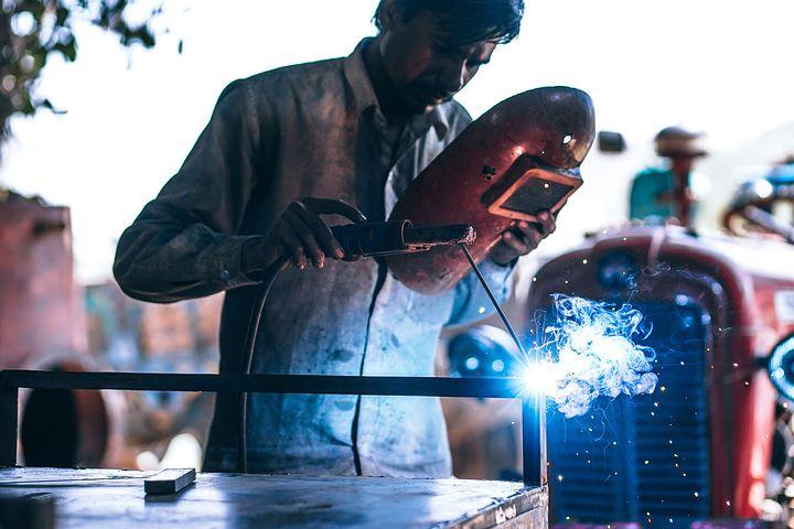 Worker using a laser cutter