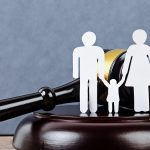 Family figure and a gavel. Family law concept